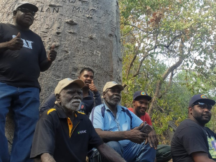 Kimberley Rangers, Robin Dann from Wunggurr, Nathan Green from Nyikina Mangala, and Bayo Taylor from Karajarri, with ASRAC's Otto Campion and Peter Djigirr and interpreter Morula.